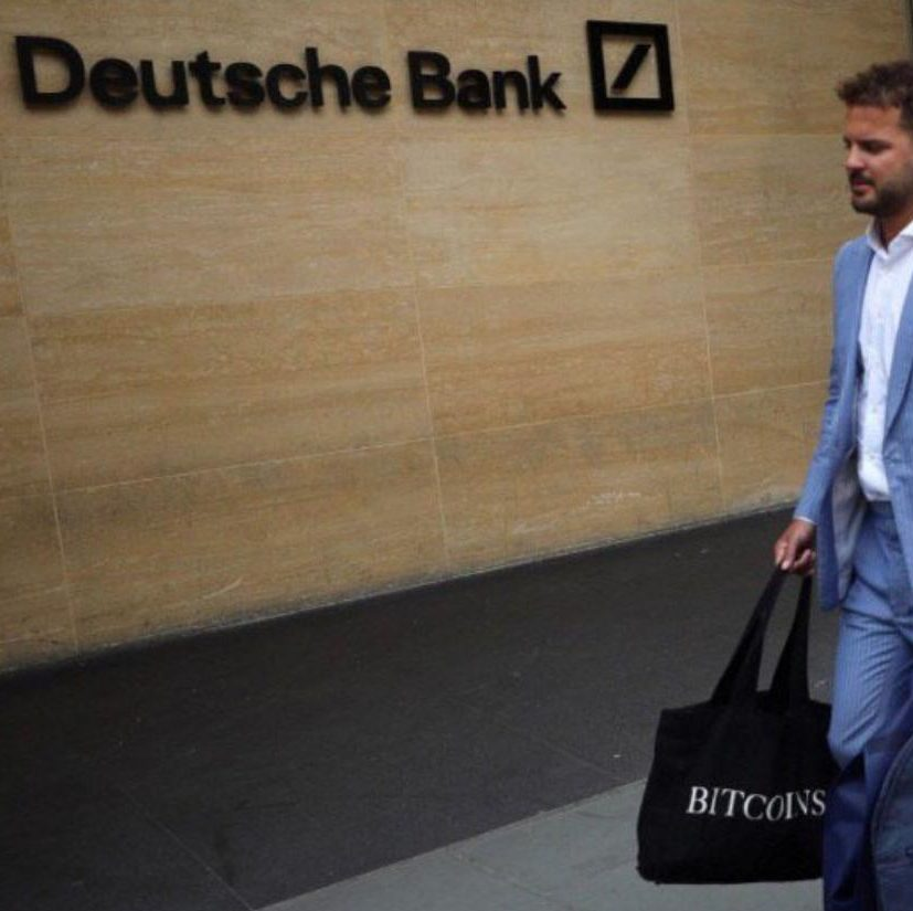 Could Deutsche Bank workers be dropping breadcrumbs? A worker leaving the banks London office spotted carrying Bitcoin bag.