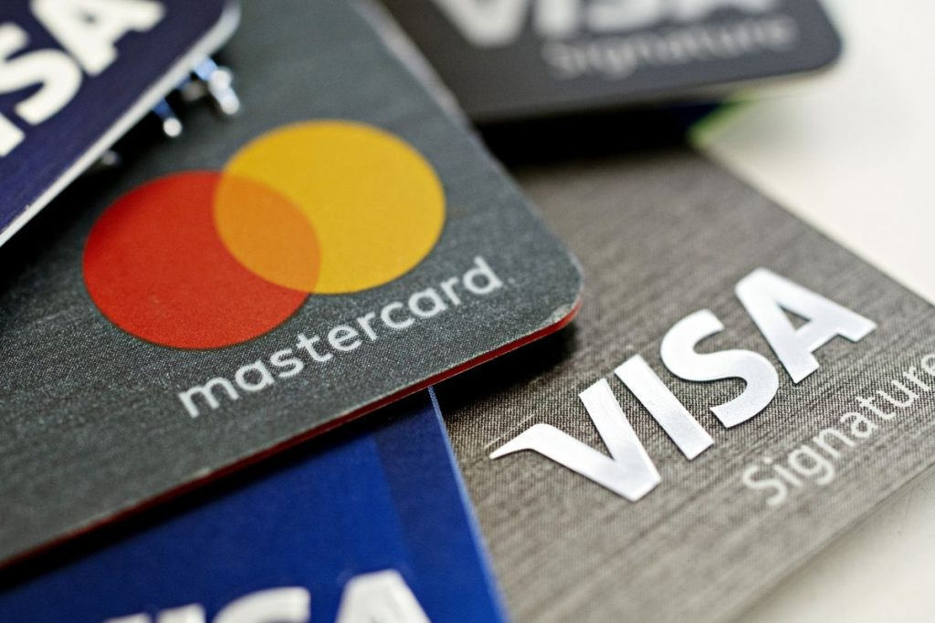 Mastercard vs Visa -  the battle of the major credit card providers for top spot comes in the form of crypto currency